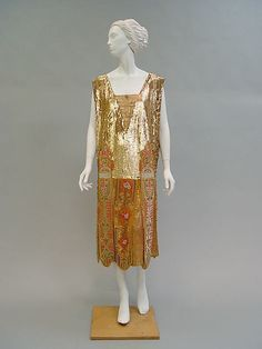 Evening dress (image 1) | House of Poiret | French | 1920s | sequins, silk, metallic, beads | Metropolitan Museum of Art | Accession Number: C.I.51.48.5a, b