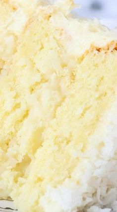 Coconut Custard Cake ~ This cake is layers of coconut cake, with a coconut custard filling and finished with a cream cheese icing.