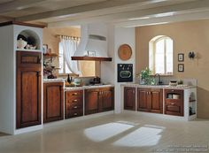 Idea of the Day: A classic Tuscan kitchen with rich golden-brown cabinets plaster walls and travertine tile countertops. By Latini Cucine. Very nice two tone white golden brown wood italian old world Brown Cabinets, White Kitchen Cabinets, Painting Kitchen Cabinets, Kitchen Paint, Kitchen Backsplash, Tile Countertops, Kitchen Cabinet Manufacturers, Kitchen Drawing, Brown Decor