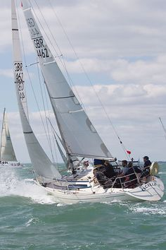 The Sigma 33 yacht 'Excelle' racing in the Solent during Cowes Week 2013.