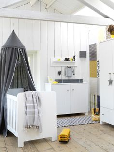 Love grey and yellow. Very chic and modern. Although I'd probably more color and some softer elements.