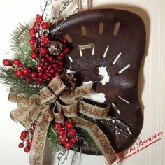 Old rusty tractor seat repurposed into a wreath.
