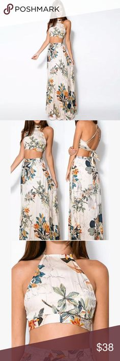 Floral Print Halter Top and Maxi Skirt Set New with tags. Floral Print. Halter top. Maxi Skirt Matching two piece Set. Top crosses in back and ties. Maxi skirt has hidden back Zipper. The Summer Blonde Skirts Maxi