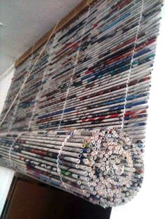 The crafting possibilities with newspaper never end! Make some DIY Roman Blinds from rolled newspaper strips.