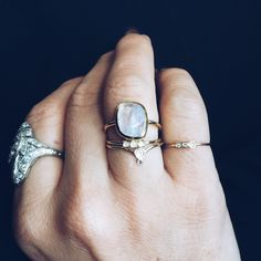 A brilliantly cut moonstone is bezel set on a yellow gold plated band. A statement cocktail ring that you won't want to reserve for special occasions. The cut of the moonstone is so perfect that when