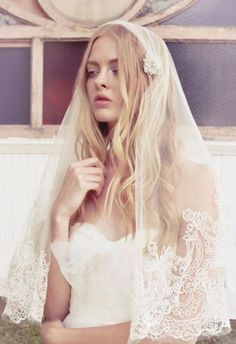 Wearing her hair down with the veil is fabulous!