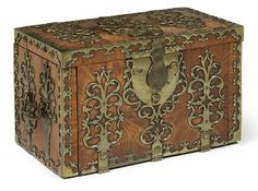 A LOUIS XIV BRASS-BOUND SOLID KINGWOOD STRONG BOX  EARLY 18TH CENTURY  Mounted overall with pierced scrolled lockplates and hinges, the rectangular hinged lid enclosing a hinged flap, the hinged-front enclosing two drawers beneath two secret compartments, the interior with a blank compartment and a lock for the hinged-front, the sides with carrying-handles, the underside with a paper label inscribed in ink '1 DRAWING ROOM'
