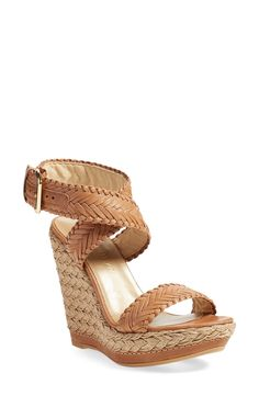 Free shipping and returns on Stuart Weitzman 'Elixir' Sandal (Women) at Nordstrom.com. Wide, braided leather straps lend easy bohemian flair to an earthy sandal set on a jute-wrapped platform wedge.