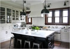 Kitchen-Traditional-Chicago-black-farmhouse-sink-glass-front-cabinets-kitchenaid-mixer-marais-stools-pendant-lights-range-hood-schoolhouse-sconces-stainless-steel-appliances-subway-tiles-swing-arm-lights-white-cabinets-w-id-1072.jpg 996×704 pixels #LGLimitlessDesign & #Contest