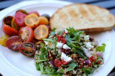 Arugula, quinoa, heirloom tomatoes, goat cheese and lemon/olive oil dressing. yummeee!
