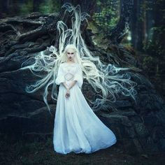 kylli sparre  - Kylli Sparre's background in dance plays an influential role in her photography. She merges graceful, dancer-like figures with surreal backdr...