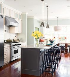 like the white cabinets, black island w/chairs. floors are a little too cherry for me but i even like the mint wall color