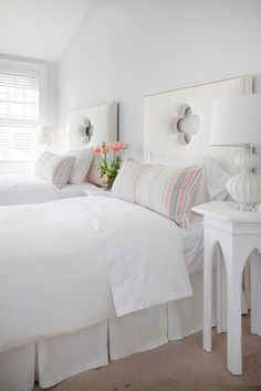 Wouldn't you love to snuggle in for the night in this sweet white guest bedroom?  I'm inspired by the thoughtful ideas incorporated here, like the quatrefoil cut-out headboards and pretty side tables.