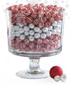 A Trifle Bowl is a lovely way to serve up all of your favorite dessert recipes, but with a little imagination it can do so much more. Here are a few fun ways to turn your Trifle Bowl into a festive and functional centerpiece.  Don't have a Trifle Bowl? Get one here. www.pamperedchef.biz/jmenting