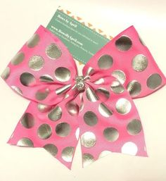 Bows by April - Pink with Silver Foil Polka Dots Ribbon Cheer Bow, $10.00 (http://www.bowsbyapril.com/pink-with-silver-foil-polka-dots-ribbon-cheer-bow/)