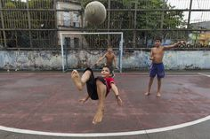 """Boys play a Sunday """"pelada"""" soccer match in the center of Manaus, a World Cup host city in Brazil, May 4, 2014. REUTERS/Bruno Kelly"""
