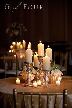mercury glass candlesticks, chunky candles & votives. So pretty. Just make sure your hall will allow open flame with the pillar candles.