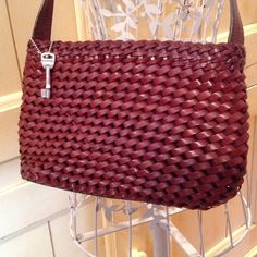 Fossil leather purse Fossil brown woven leather shoulder bag, zip top, very gently worn, clean interior, perfect for fall! Fossil Bags Shoulder Bags