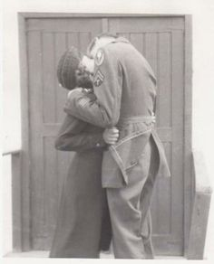 US Army Nurse kissing a Corporal. They were just married ~