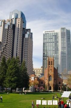 California - Downtown San Francisco at the Yerba Buena Gardens looking at St. Patrick's Church and the Marriott with the Four Seasons in the background