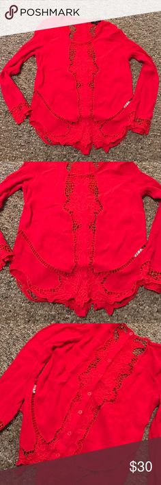 Red blouse Crocheted edges and sleeves. Very pretty red. Buttons feature down the back. No damage. Like new. Monteau Tops Blouses