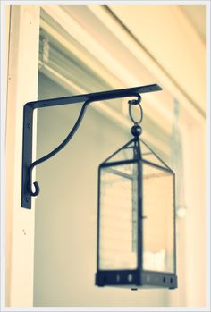 IKEA Hackers: lighting. Use a shelf corner to hang a lantern on your patio.
