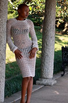 Photo Credits: Alexa Welch Edlund  Richmond Times Dispatch    This item is made to order: Please allow 2-3 weeks for item completion    This crochet open net dress is very flattering on any woman! It is made with an off the shoulder design that can also be worn up over the shoulders. Elastic is built into the shoulder area to prevent slipping.  The sleeves slouch at the wrist, creating a sense of drama to the piece. Dress falls about mid calf.
