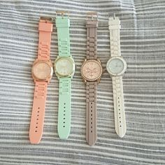 Quartz and an American Eagle Watches 3 Quartz watches and 1 American Eagle watch (white).  All are in perfectly good condition, need new batteries. The coral and mint colored ones have gold detailing, the taupe/brown one has rose gold and crystal detailing and the white one has silver detailing. Jewelry Bracelets