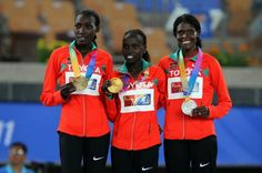 (L-R) Bronze medalist Linet Masai of Kenya, gold medalist Vivian Cheruiyot of Kenya and silver medalist Sally Kipyego of Kenya celebrate with their medals on the podium after the women's 10,000 metres final in Daegu 2011.