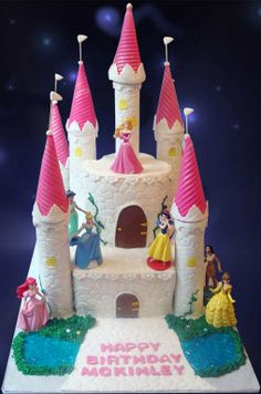 Disney Princess Castle Cake - Castle Cake for a 4 year old girl who loves Sleeping Beauty. French Vanilla with Cookies n creme filling. 10 inch square and 6 inch round.
