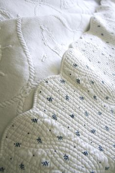 Bleached White Matelassé Coverlet with Dainty Blue Leaf Pattern .