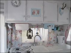 After kitchen sink details...it's not wallpaper on the backsplash...it's the window curtains.