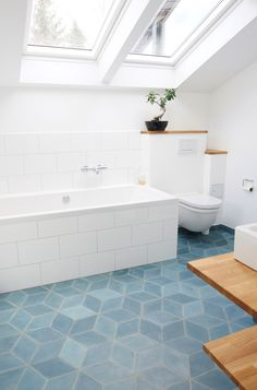 Geometric tile blue block tile floor in white bathroom - bathroom flooring Bathroom Tile Designs, Bathroom Floor Tiles, Bathroom Renos, Bathroom Interior, Bathroom Ideas, Attic Bathroom, Kitchen Floor, Funky Bathroom, Bathtub Designs