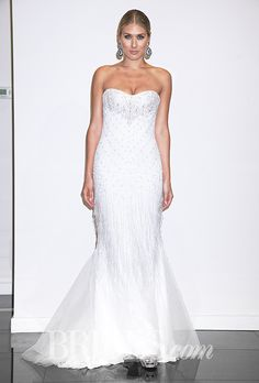 Brides.com: . Trend: Fringe. Strapless mermaid wedding dress with a sweetheart neckline, beaded bodice details, and fringe accents on the skirt, Victor Harper