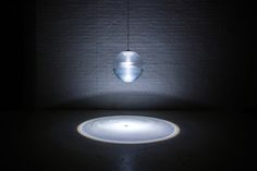 """""""Continuing with the studio's nature inspired designs, the Rain lamp uses water and an intricately designed pump system to create a shimmering, ripple effect. The inherent shape of the globe acts as a magnifying lens that projects onto the surface below. LED technology allows for the mixing of light and water in ways that have never before been possible, in a design that is safe, compact and durable. Estimated to last over 100,000 hours, the LED bulb is both stunningly bright and…"""