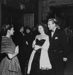 Ann Blyth chats with Susan Hayward and husband Jess Barker in 1950