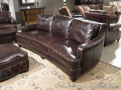 dark brown curved leather sofa with nail heads- Country Willow Furniture