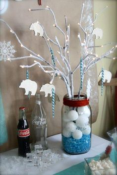 2nd Birthday Party Ideas for Boys | Winter Wonderland Theme. Mason jar with weight... painted branches