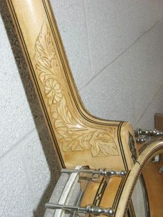 I always thought the carving on my banjo was done by one of the previous owners, but it looks as if it came that way.