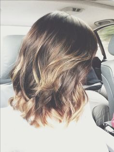 Wavy, dark blond with highlights bob or lob, hard to say.