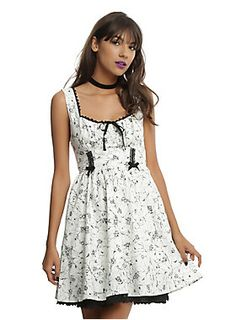 <div>Look closely before you smell the flowers on this dress, you might get more than you bargained for! The ivory fit and flare dress has an allover black distressed branch and floral print with random creepy-crawlies mixed in. The bodice has a black crochet accented gathered neckline and tank straps, black ribbon tie accent at center bust and a banded waist with vertical black lace and ribbon bow detail A fitted elastic waistband leads to a full skirt with pockets and black lace…