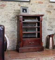 Baumhaus La Roque Mahogany Entertainment #Cabinet is a striking, charming looking home Hi fi and entertainment unit that gives you easy access to all your media devices. This Entertainment cabinet has a thick flat base with nylon. #Furniture #LivingroomFurniture #FurnitureDesign #FurnitureIdeas #Interior
