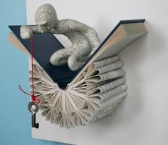 Daniel Lai from Knoxville makes beautiful book scuptures.  On Etsy -- Kenjio.  This one is Traveler with a Key. Love.