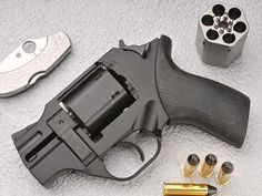 A small revolver... for my consignment store Hermes Evening Bag......just in case.  =)