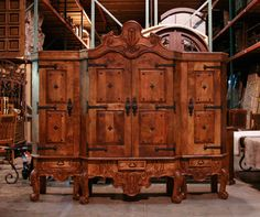 Three Piece Conquista Armoire with a traditional Spanish colonial accents