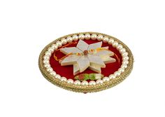 Make this Rakhi special and royal, with our rich and elegant Pearl Rakhi Thali.