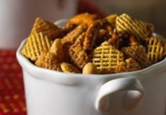 Crispix Mix - 7 cups Crispix® cereal 1 cup mixed nuts, 1 cup pretzels 3 tablespoons butter or margarine, melted, 4 teaspoons Worcestershire sauce, 2 teaspoons lemon juice 1/4 teaspoon garlic salt, 1/4 teaspoon onion salt :