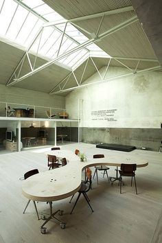 Central conference table in a huge studio space.