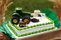 addition of a toy tractor and farm-animal figurines can make a store-bought cake fit the John Deere theme perfectly