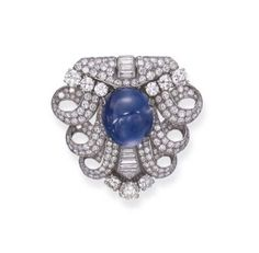 AN ART DECO DIAMOND AND SAPPHIRE BROOCH, BY BULGARI   Centering upon a cabochon sapphire, weighing approximately 44.80 carats, within three by shawna